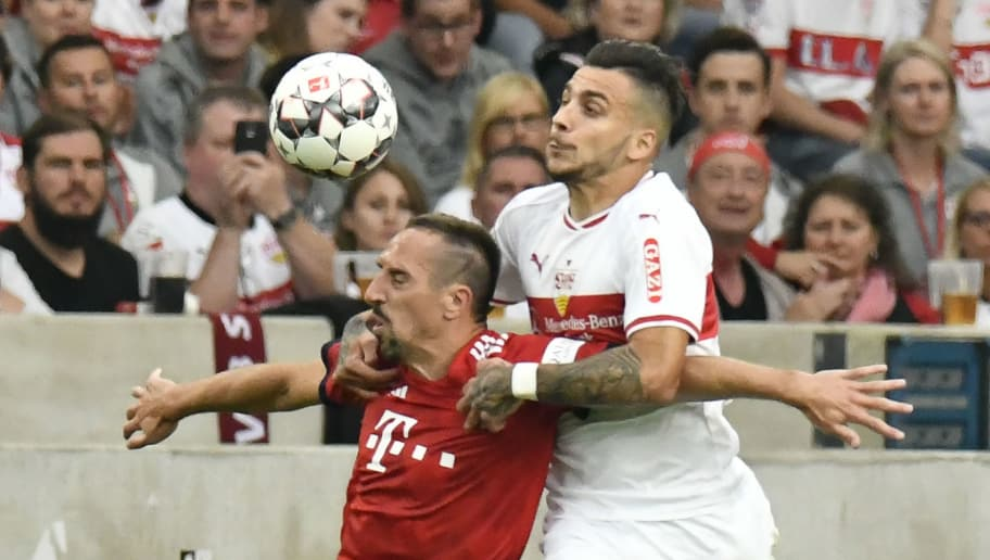 Bayern Munich's French midfielder Franck Ribery (L) and Stuttgart's Greek forward Anastasios Donis vie for the ball during the German first division Bundesliga football match VfB Stuttgart vs FC Bayern Munich in Stuttgart, southern Germany, on September 1, 2018. (Photo by THOMAS KIENZLE / AFP) / RESTRICTIONS: DFL REGULATIONS PROHIBIT ANY USE OF PHOTOGRAPHS AS IMAGE SEQUENCES AND/OR QUASI-VIDEO        (Photo credit should read THOMAS KIENZLE/AFP/Getty Images)