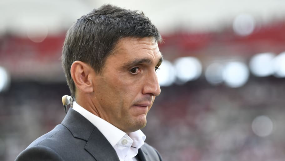 A finger points on Stuttgart's German head coach Tayfun Korkut as he gives an interview prior to the German first division Bundesliga football match VfB Stuttgart vs FC Bayern Munich in Stuttgart, southern Germany, on September 1, 2018. (Photo by THOMAS KIENZLE / AFP) / RESTRICTIONS: DFL REGULATIONS PROHIBIT ANY USE OF PHOTOGRAPHS AS IMAGE SEQUENCES AND/OR QUASI-VIDEO        (Photo credit should read THOMAS KIENZLE/AFP/Getty Images)