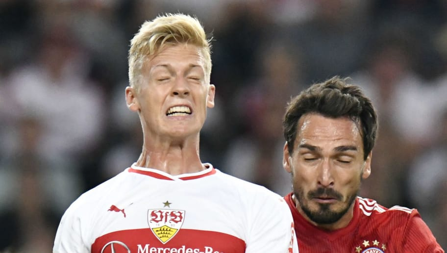 Bayern Munich's German defender Mats Hummels (R) and Stuttgart's German defender Timo Baumgartl head for the ball during the German first division Bundesliga football match VfB Stuttgart vs FC Bayern Munich in Stuttgart, southern Germany, on September 1, 2018. (Photo by THOMAS KIENZLE / AFP) / RESTRICTIONS: DFL REGULATIONS PROHIBIT ANY USE OF PHOTOGRAPHS AS IMAGE SEQUENCES AND/OR QUASI-VIDEO        (Photo credit should read THOMAS KIENZLE/AFP/Getty Images)