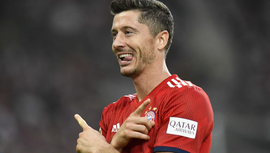 Bayern Munich's Polish forward Robert Lewandowski celebrates after scoring the 0-2 during the German first division Bundesliga football match VfB Stuttgart vs FC Bayern Munich in Stuttgart, southern Germany, on September 1, 2018. (Photo by THOMAS KIENZLE / AFP) / RESTRICTIONS: DFL REGULATIONS PROHIBIT ANY USE OF PHOTOGRAPHS AS IMAGE SEQUENCES AND/OR QUASI-VIDEO        (Photo credit should read THOMAS KIENZLE/AFP/Getty Images)