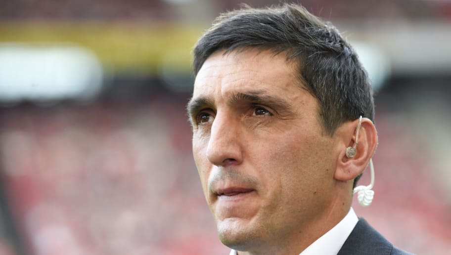 Stuttgart's German head coach Tayfun Korkut gives an interview prior to the German first division Bundesliga football match VfB Stuttgart vs FC Bayern Munich in Stuttgart, southern Germany, on September 1, 2018. (Photo by THOMAS KIENZLE / AFP) / RESTRICTIONS: DFL REGULATIONS PROHIBIT ANY USE OF PHOTOGRAPHS AS IMAGE SEQUENCES AND/OR QUASI-VIDEO        (Photo credit should read THOMAS KIENZLE/AFP/Getty Images)