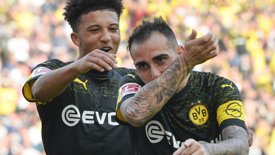 Dortmund's Spanish forward Paco Alcacer (R) celebrates with teammate English midfielder Jadon Sancho after Alcacer scored the team's third goal during the German first division Bundesliga football match VfB Stuttgart vs BVB Borussia Dortmund on October 20, 2018 in Stuttgart. (Photo by THOMAS KIENZLE / AFP) / RESTRICTIONS: DFL REGULATIONS PROHIBIT ANY USE OF PHOTOGRAPHS AS IMAGE SEQUENCES AND/OR QUASI-VIDEO        (Photo credit should read THOMAS KIENZLE/AFP/Getty Images)