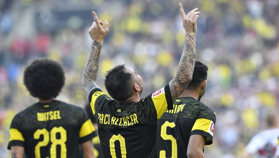 Dortmund's Spanish forward Paco Alcacer (C) celebrates after he scored his team 3rd goal during the German first division Bundesliga football match VfB Stuttgart vs BVB Borussia Dortmund on October 20, 2018 in Stuttgart. (Photo by Thomas KIENZLE / AFP) / RESTRICTIONS: DFL REGULATIONS PROHIBIT ANY USE OF PHOTOGRAPHS AS IMAGE SEQUENCES AND/OR QUASI-VIDEO        (Photo credit should read THOMAS KIENZLE/AFP/Getty Images)