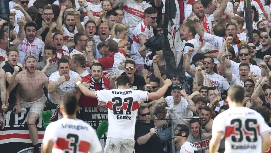 Stuttgart's forward Mario Gomez (C) celebrates in front of supporters after he scored a goal during the German first division Bundesliga football match VfB Stuttgart vs TSG 1899 Hoffenheim in Stuttgart, southern Germany, on May 5, 2018. (Photo by THOMAS KIENZLE / AFP) / RESTRICTIONS: DURING MATCH TIME: DFL RULES TO LIMIT THE ONLINE USAGE TO 15 PICTURES PER MATCH AND FORBID IMAGE SEQUENCES TO SIMULATE VIDEO. == RESTRICTED TO EDITORIAL USE == FOR FURTHER QUERIES PLEASE CONTACT DFL DIRECTLY AT + 49 69 650050        (Photo credit should read THOMAS KIENZLE/AFP/Getty Images)