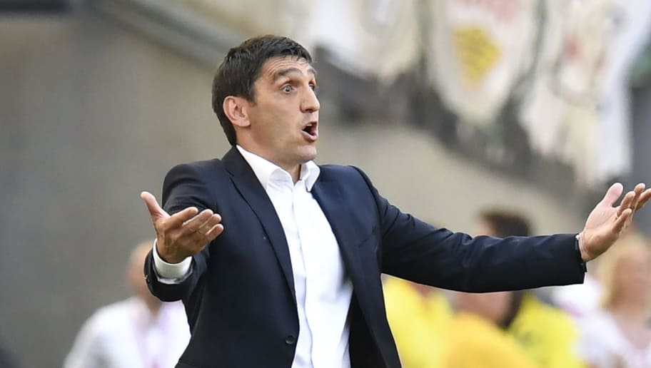 Stuttgart's Turkish head coach Tayfun Korkut reacts during the German first division Bundesliga football match VfB Stuttgart vs TSG 1899 Hoffenheim in Stuttgart, southwestern Germany, on May 5, 2018. (Photo by THOMAS KIENZLE / AFP) / RESTRICTIONS: DURING MATCH TIME: DFL RULES TO LIMIT THE ONLINE USAGE TO 15 PICTURES PER MATCH AND FORBID IMAGE SEQUENCES TO SIMULATE VIDEO. == RESTRICTED TO EDITORIAL USE == FOR FURTHER QUERIES PLEASE CONTACT DFL DIRECTLY AT + 49 69 650050        (Photo credit should read THOMAS KIENZLE/AFP/Getty Images)