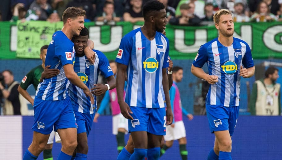 Berlin's Dutch forward Javairo Dilrosun (2ndL) celebrates scoring his team's first goal during the German First division Bundesliga football match between VfL Wolfsburg and Hertha Berlin in Wolfsburg, on September 15, 2018. (Photo by ODD ANDERSEN / AFP) / DFL REGULATIONS PROHIBIT ANY USE OF PHOTOGRAPHS AS IMAGE SEQUENCES AND/OR QUASI-VIDEO        (Photo credit should read ODD ANDERSEN/AFP/Getty Images)