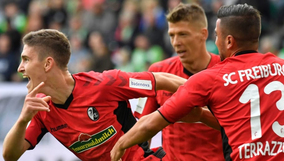 Freiburg's Hungarian midfielder Roland Sallai celebrates after scoring during the German First division Bundesliga football match between VfL Wolfsburg and SC Freiburg in Wolfsburg, on September 22, 2018. (Photo by John MACDOUGALL / AFP) / DFL REGULATIONS PROHIBIT ANY USE OF PHOTOGRAPHS AS IMAGE SEQUENCES AND/OR QUASI-VIDEO        (Photo credit should read JOHN MACDOUGALL/AFP/Getty Images)