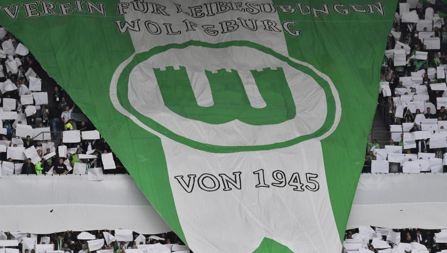 Wolfsburg supporters display a giant team insigna prior to the German First division Bundesliga football match between VfL Wolfsburg and SC Freiburg in Wolfsburg, on September 22, 2018. (Photo by John MACDOUGALL / AFP) / DFL REGULATIONS PROHIBIT ANY USE OF PHOTOGRAPHS AS IMAGE SEQUENCES AND/OR QUASI-VIDEO        (Photo credit should read JOHN MACDOUGALL/AFP/Getty Images)