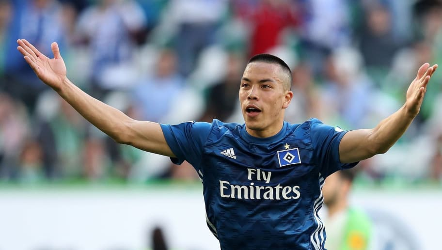 Hamburg's US striker Bobby Wood celebrates after scoring during the German first division Bundesliga football match VfL Wolfsburg vs Hamburger SV in Wolfsburg, northern Germany, on April 28, 2018. (Photo by Ronny Hartmann / AFP) / RESTRICTIONS: DURING MATCH TIME: DFL RULES TO LIMIT THE ONLINE USAGE TO 15 PICTURES PER MATCH AND FORBID IMAGE SEQUENCES TO SIMULATE VIDEO. == RESTRICTED TO EDITORIAL USE == FOR FURTHER QUERIES PLEASE CONTACT DFL DIRECTLY AT + 49 69 650050        (Photo credit should read RONNY HARTMANN/AFP/Getty Images)