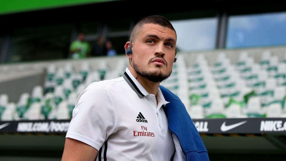 Hamburg's Greek defender Kyriakos Papadopoulos arrives prior to the German first division Bundesliga football match VfL Wolfsburg vs Hamburger SV in Wolfsburg, northern Germany, on April 28, 2018. (Photo by Ronny Hartmann / AFP) / RESTRICTIONS: DURING MATCH TIME: DFL RULES TO LIMIT THE ONLINE USAGE TO 15 PICTURES PER MATCH AND FORBID IMAGE SEQUENCES TO SIMULATE VIDEO. == RESTRICTED TO EDITORIAL USE == FOR FURTHER QUERIES PLEASE CONTACT DFL DIRECTLY AT + 49 69 650050        (Photo credit should read RONNY HARTMANN/AFP/Getty Images)