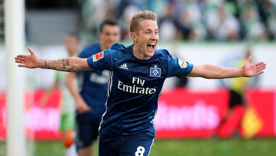 Hamburg's German midfielder Lewis Holtby celebrates after scoring his team's second goal during the German first division Bundesliga football match VfL Wolfsburg vs Hamburger SV in Wolfsburg, northern Germany, on April 28, 2018. (Photo by Ronny Hartmann / AFP) / RESTRICTIONS: DURING MATCH TIME: DFL RULES TO LIMIT THE ONLINE USAGE TO 15 PICTURES PER MATCH AND FORBID IMAGE SEQUENCES TO SIMULATE VIDEO. == RESTRICTED TO EDITORIAL USE == FOR FURTHER QUERIES PLEASE CONTACT DFL DIRECTLY AT + 49 69 650050        (Photo credit should read RONNY HARTMANN/AFP/Getty Images)