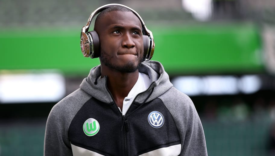 Wolfsburg's French midfielder Josuha Guilavogui arrives prior to the German first division Bundesliga football match VfL Wolfsburg vs Hamburger SV in Wolfsburg, northern Germany, on April 28, 2018. (Photo by Ronny Hartmann / AFP) / RESTRICTIONS: DURING MATCH TIME: DFL RULES TO LIMIT THE ONLINE USAGE TO 15 PICTURES PER MATCH AND FORBID IMAGE SEQUENCES TO SIMULATE VIDEO. == RESTRICTED TO EDITORIAL USE == FOR FURTHER QUERIES PLEASE CONTACT DFL DIRECTLY AT + 49 69 650050        (Photo credit should read RONNY HARTMANN/AFP/Getty Images)