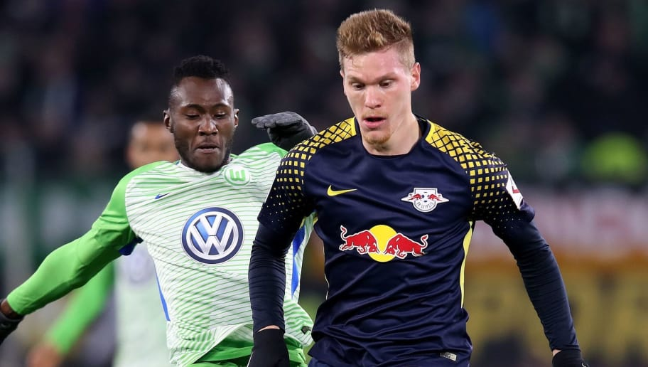 Leipzig's defender Marcel Halstenberg (R) and Wolfsburg's French defender Josuha Guilavogui (L) vie for the ball during the German first division Bundesliga football match between VfL Wolfsburg and RB Leipzig on December 12, 2017 in Wolfsburg.  / AFP PHOTO / Ronny Hartmann / RESTRICTIONS: DURING MATCH TIME: DFL RULES TO LIMIT THE ONLINE USAGE TO 15 PICTURES PER MATCH AND FORBID IMAGE SEQUENCES TO SIMULATE VIDEO. == RESTRICTED TO EDITORIAL USE == FOR FURTHER QUERIES PLEASE CONTACT DFL DIRECTLY AT + 49 69 650050         (Photo credit should read RONNY HARTMANN/AFP/Getty Images)