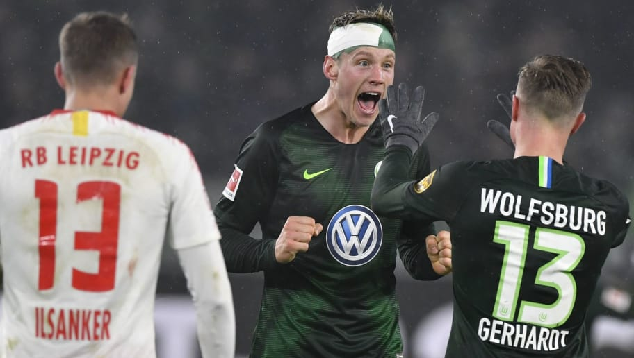 Wolfsburg's Dutch forward Wout Weghorst and Wolfsburg's German defender Yannick Gerhardt (R) celebrate after the German first division Bundesliga football match between VfL Wolfsburg and RB Leipzig in Wolfsburg, northern Germany on November 24, 2018. (Photo by John MACDOUGALL / AFP) / RESTRICTIONS: DFL REGULATIONS PROHIBIT ANY USE OF PHOTOGRAPHS AS IMAGE SEQUENCES AND/OR QUASI-VIDEO        (Photo credit should read JOHN MACDOUGALL/AFP/Getty Images)