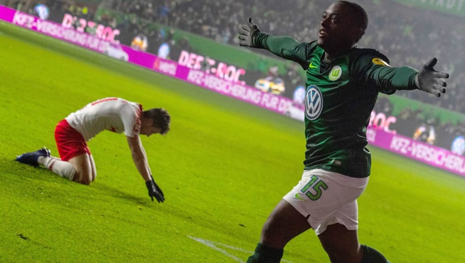 Wolfsburg's French defender Jerome Roussillon celebrates after scoring during the German first division Bundesliga football match between VfL Wolfsburg and RB Leipzig in Wolfsburg, northern Germany on November 24, 2018. (Photo by John MACDOUGALL / AFP) / RESTRICTIONS: DFL REGULATIONS PROHIBIT ANY USE OF PHOTOGRAPHS AS IMAGE SEQUENCES AND/OR QUASI-VIDEO        (Photo credit should read JOHN MACDOUGALL/AFP/Getty Images)