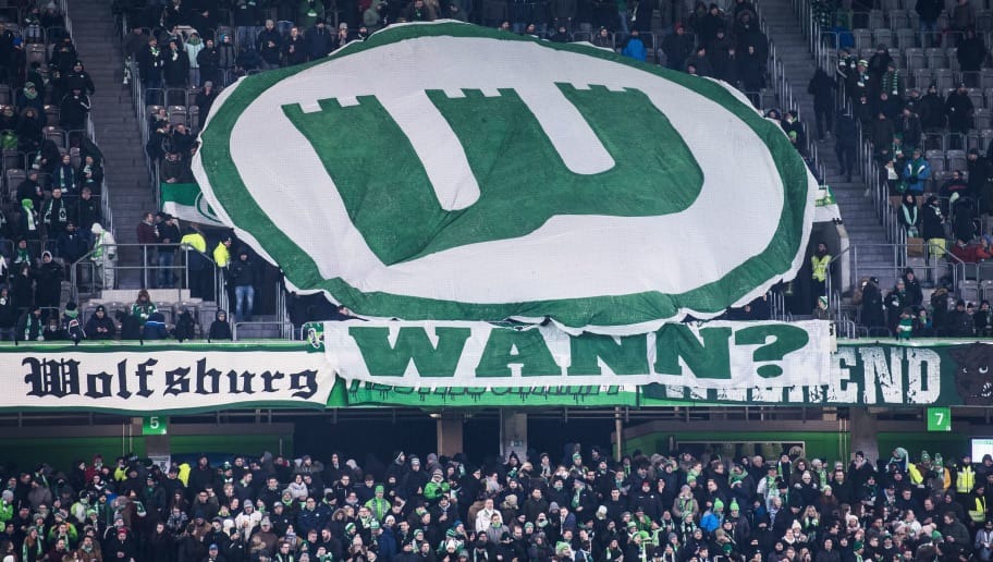 Wolfsburg supporters display a giant Wolfsburg logo during the German First division Bundesliga football match VfL Wolfsburg vs Schalke 04, in Wolfsburg, on March 17, 2018. / AFP PHOTO / John MACDOUGALL / RESTRICTIONS: DURING MATCH TIME: DFL RULES TO LIMIT THE ONLINE USAGE TO 15 PICTURES PER MATCH AND FORBID IMAGE SEQUENCES TO SIMULATE VIDEO. == RESTRICTED TO EDITORIAL USE == FOR FURTHER QUERIES PLEASE CONTACT DFL DIRECTLY AT + 49 69 650050  / RESTRICTIONS: DURING MATCH TIME: DFL RULES TO LIMIT THE ONLINE USAGE TO 15 PICTURES PER MATCH AND FORBID IMAGE SEQUENCES TO SIMULATE VIDEO. == RESTRICTED TO EDITORIAL USE == FOR FURTHER QUERIES PLEASE CONTACT DFL DIRECTLY AT + 49 69 650050        (Photo credit should read JOHN MACDOUGALL/AFP/Getty Images)
