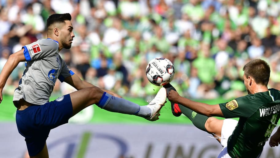 Schalke's German midfielder Suat Serdar (L) andWolfsburg's Spanish midfielder Ignacio Camacho vie for the ball during the German first division Bundesliga football match VfL Wolfsburg v FC Schalke 04 in Wolfsburg, northern Germany, on August 25, 2018. (Photo by Tobias SCHWARZ / AFP) / RESTRICTIONS: DFL REGULATIONS PROHIBIT ANY USE OF PHOTOGRAPHS AS IMAGE SEQUENCES AND/OR QUASI-VIDEO        (Photo credit should read TOBIAS SCHWARZ/AFP/Getty Images)