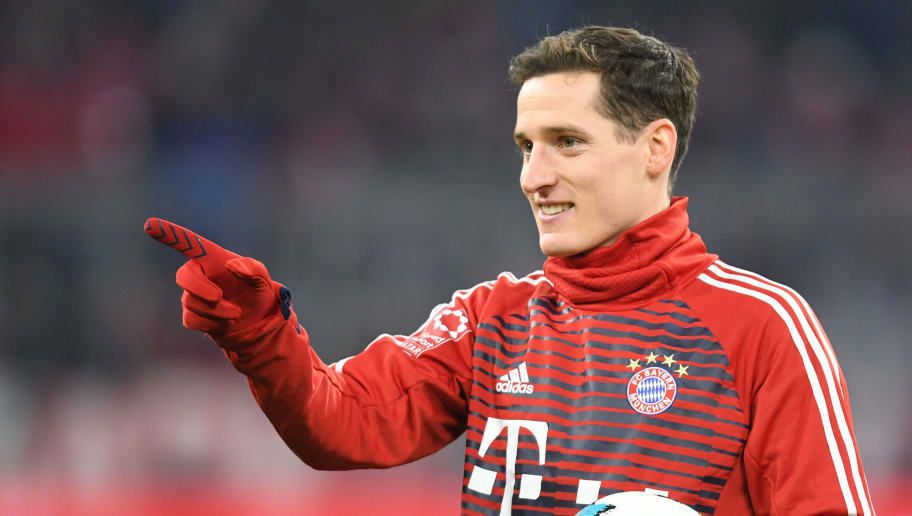 Bayern Munich's German midfielder Sebastian Rudy gestures during the warm up prior the German football Cup DFB Pokal round of sixteen match Bayern Munich vs Borussia Dortmund in Munich, southern Germany, on December 20, 2017.  / AFP PHOTO / CHRISTOF STACHE        (Photo credit should read CHRISTOF STACHE/AFP/Getty Images)