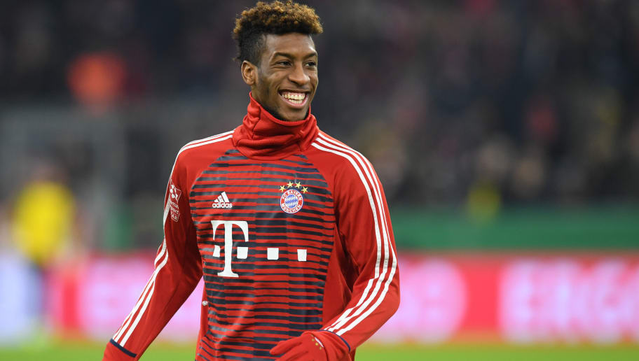 Bayern Munich's French defender Kingsley Coman smiles before the German football Cup DFB Pokal round of sixteen match Bayern Munich vs Dortmund on December 20, 2017 in Munich.  / AFP PHOTO / Christof STACHE / RESTRICTIONS: ACCORDING TO DFB RULES IMAGE SEQUENCES TO SIMULATE VIDEO IS NOT ALLOWED DURING MATCH TIME. MOBILE (MMS) USE IS NOT ALLOWED DURING AND FOR FURTHER TWO HOURS AFTER THE MATCH. == RESTRICTED TO EDITORIAL USE == FOR MORE INFORMATION CONTACT DFB DIRECTLY AT +49 69 67880   /         (Photo credit should read CHRISTOF STACHE/AFP/Getty Images)