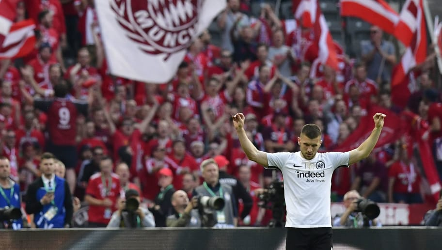 Frankfurt's Croatian forward Ante Rebic celebrates scoring during the German Cup DFB Pokal final football match FC Bayern Munich vs Eintracht Frankfurt at the Olympic Stadium in Berlin on May 19, 2018. (Photo by Tobias SCHWARZ / AFP) / RESTRICTIONS: ACCORDING TO DFB RULES IMAGE SEQUENCES TO SIMULATE VIDEO IS NOT ALLOWED DURING MATCH TIME. MOBILE (MMS) USE IS NOT ALLOWED DURING AND FOR FURTHER TWO HOURS AFTER THE MATCH. == RESTRICTED TO EDITORIAL USE == FOR MORE INFORMATION CONTACT DFB DIRECTLY AT +49 69 67880 /         (Photo credit should read TOBIAS SCHWARZ/AFP/Getty Images)