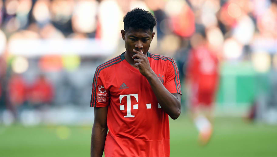 Bayern Munich's Austrian defender David Alaba warms up prior to the German Cup DFB Pokal final football match FC Bayern Munich vs Eintracht Frankfurt at the Olympic Stadium in Berlin on May 19, 2018. (Photo by Christof STACHE / AFP) / RESTRICTIONS: ACCORDING TO DFB RULES IMAGE SEQUENCES TO SIMULATE VIDEO IS NOT ALLOWED DURING MATCH TIME. MOBILE (MMS) USE IS NOT ALLOWED DURING AND FOR FURTHER TWO HOURS AFTER THE MATCH. == RESTRICTED TO EDITORIAL USE == FOR MORE INFORMATION CONTACT DFB DIRECTLY AT +49 69 67880 /         (Photo credit should read CHRISTOF STACHE/AFP/Getty Images)
