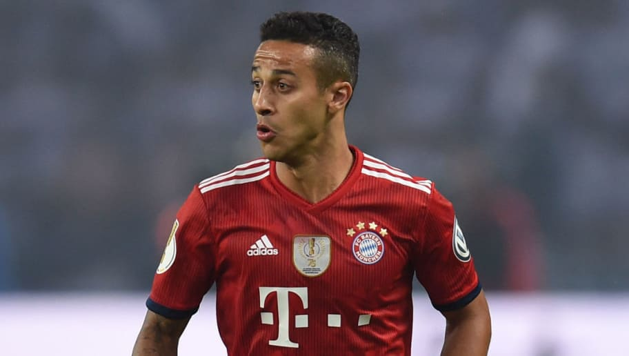 Bayern Munich's Spanish midfielder Thiago Alcantara controls the ball during the German Cup DFB Pokal final football match FC Bayern Munich vs Eintracht Frankfurt at the Olympic Stadium in Berlin on May 19, 2018. (Photo by Christof STACHE / AFP) / RESTRICTIONS: ACCORDING TO DFB RULES IMAGE SEQUENCES TO SIMULATE VIDEO IS NOT ALLOWED DURING MATCH TIME. MOBILE (MMS) USE IS NOT ALLOWED DURING AND FOR FURTHER TWO HOURS AFTER THE MATCH. == RESTRICTED TO EDITORIAL USE == FOR MORE INFORMATION CONTACT DFB DIRECTLY AT +49 69 67880 /         (Photo credit should read CHRISTOF STACHE/AFP/Getty Images)