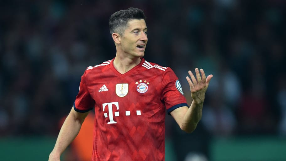 Bayern Munich's Polish striker Robert Lewandowski reacts during the German Cup DFB Pokal final football match FC Bayern Munich vs Eintracht Frankfurt at the Olympic Stadium in Berlin on May 19, 2018. (Photo by Christof STACHE / AFP) / RESTRICTIONS: ACCORDING TO DFB RULES IMAGE SEQUENCES TO SIMULATE VIDEO IS NOT ALLOWED DURING MATCH TIME. MOBILE (MMS) USE IS NOT ALLOWED DURING AND FOR FURTHER TWO HOURS AFTER THE MATCH. == RESTRICTED TO EDITORIAL USE == FOR MORE INFORMATION CONTACT DFB DIRECTLY AT +49 69 67880 /         (Photo credit should read CHRISTOF STACHE/AFP/Getty Images)