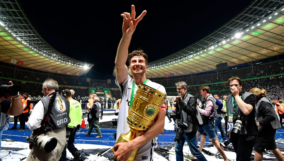 Frankfurt's Argentinian defender David Abraham celebrates with the trophy after the German Cup DFB Pokal final football match FC Bayern Munich vs Eintracht Frankfurt at the Olympic Stadium in Berlin on May 19, 2018. (Photo by Tobias SCHWARZ / AFP) / RESTRICTIONS: ACCORDING TO DFB RULES IMAGE SEQUENCES TO SIMULATE VIDEO IS NOT ALLOWED DURING MATCH TIME. MOBILE (MMS) USE IS NOT ALLOWED DURING AND FOR FURTHER TWO HOURS AFTER THE MATCH. == RESTRICTED TO EDITORIAL USE == FOR MORE INFORMATION CONTACT DFB DIRECTLY AT +49 69 67880 /         (Photo credit should read TOBIAS SCHWARZ/AFP/Getty Images)