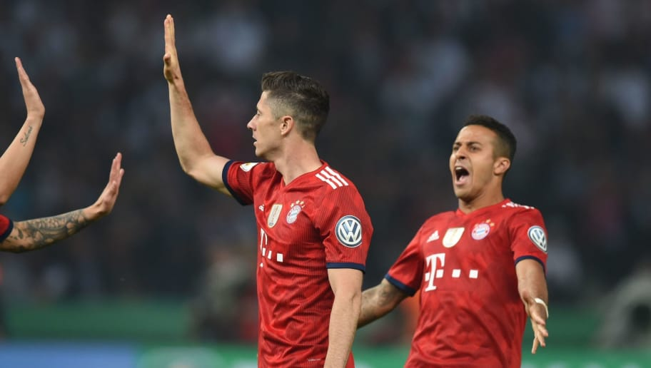 Bayern Munich's Polish forward Robert Lewandowski(C) celebrates scoring with his teammates Colombian midfielder James Rodriguez (L) and Spanish midfielder Thiago Alcantara during the German Cup DFB Pokal final football match FC Bayern Munich vs Eintracht Frankfurt at the Olympic Stadium in Berlin on May 19, 2018. (Photo by Christof STACHE / AFP) / RESTRICTIONS: ACCORDING TO DFB RULES IMAGE SEQUENCES TO SIMULATE VIDEO IS NOT ALLOWED DURING MATCH TIME. MOBILE (MMS) USE IS NOT ALLOWED DURING AND FOR FURTHER TWO HOURS AFTER THE MATCH. == RESTRICTED TO EDITORIAL USE == FOR MORE INFORMATION CONTACT DFB DIRECTLY AT +49 69 67880 /         (Photo credit should read CHRISTOF STACHE/AFP/Getty Images)