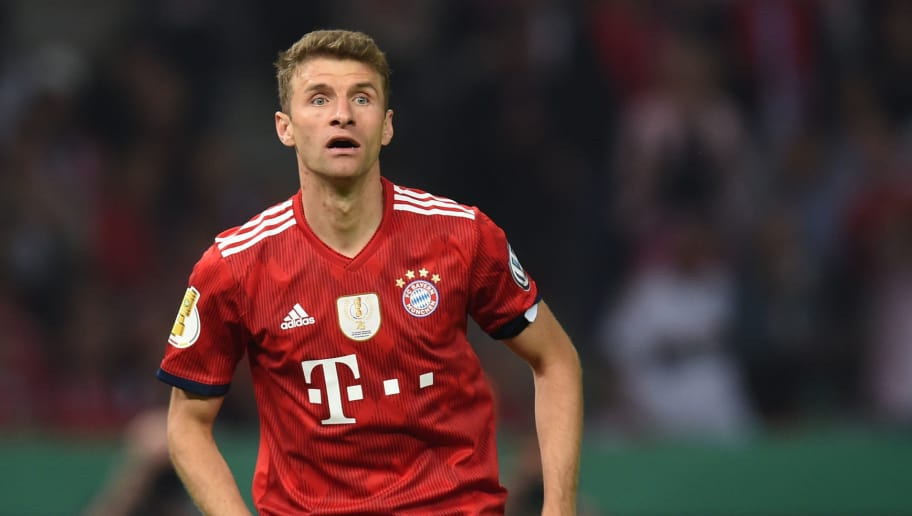 Bayern Munich's striker Thomas Mueller reacts during the German Cup DFB Pokal final football match FC Bayern Munich vs Eintracht Frankfurt at the Olympic Stadium in Berlin on May 19, 2018. (Photo by Christof STACHE / AFP) / RESTRICTIONS: ACCORDING TO DFB RULES IMAGE SEQUENCES TO SIMULATE VIDEO IS NOT ALLOWED DURING MATCH TIME. MOBILE (MMS) USE IS NOT ALLOWED DURING AND FOR FURTHER TWO HOURS AFTER THE MATCH. == RESTRICTED TO EDITORIAL USE == FOR MORE INFORMATION CONTACT DFB DIRECTLY AT +49 69 67880 /         (Photo credit should read CHRISTOF STACHE/AFP/Getty Images)