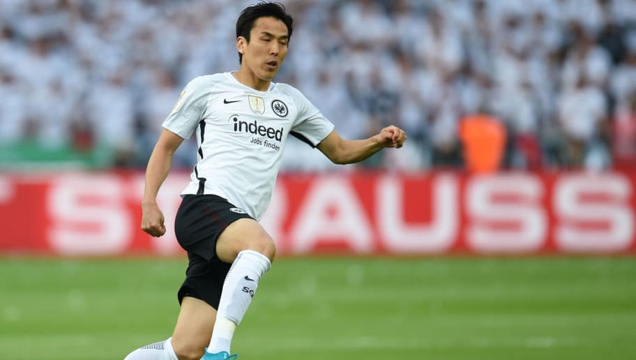 Frankfurt's Japanese midfielder Makoto Hasebe jumps during the German Cup DFB Pokal final football match FC Bayern Munich vs Eintracht Frankfurt at the Olympic Stadium in Berlin on May 19, 2018. (Photo by Christof STACHE / AFP) / RESTRICTIONS: ACCORDING TO DFB RULES IMAGE SEQUENCES TO SIMULATE VIDEO IS NOT ALLOWED DURING MATCH TIME. MOBILE (MMS) USE IS NOT ALLOWED DURING AND FOR FURTHER TWO HOURS AFTER THE MATCH. == RESTRICTED TO EDITORIAL USE == FOR MORE INFORMATION CONTACT DFB DIRECTLY AT +49 69 67880 /         (Photo credit should read CHRISTOF STACHE/AFP/Getty Images)