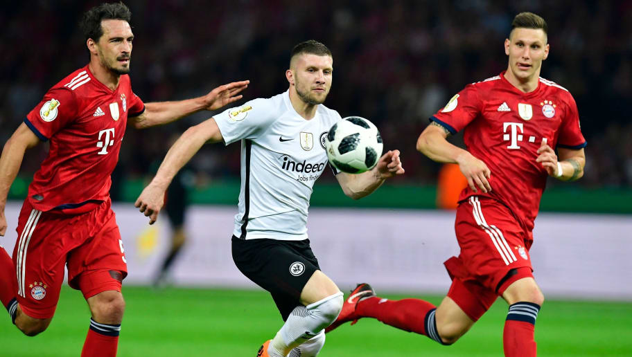 Frankfurt's Croatian forward Ante Rebic (C) vies with Bayern Munich's German defender Niklas Suele (R) and Bayern Munich's German defender Mats Hummels during the German Cup DFB Pokal final football match FC Bayern Munich vs Eintracht Frankfurt at the Olympic Stadium in Berlin on May 19, 2018. (Photo by Tobias SCHWARZ / AFP) / RESTRICTIONS: ACCORDING TO DFB RULES IMAGE SEQUENCES TO SIMULATE VIDEO IS NOT ALLOWED DURING MATCH TIME. MOBILE (MMS) USE IS NOT ALLOWED DURING AND FOR FURTHER TWO HOURS AFTER THE MATCH. == RESTRICTED TO EDITORIAL USE == FOR MORE INFORMATION CONTACT DFB DIRECTLY AT +49 69 67880 /         (Photo credit should read TOBIAS SCHWARZ/AFP/Getty Images)