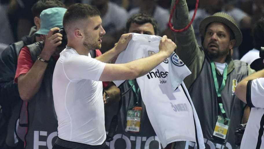 Frankfurt's Croatian forward Ante Rebic shows his jersey after scoring during the German Cup DFB Pokal final football match FC Bayern Munich vs Eintracht Frankfurt at the Olympic Stadium in Berlin on May 19, 2018. (Photo by Tobias SCHWARZ / AFP) / RESTRICTIONS: ACCORDING TO DFB RULES IMAGE SEQUENCES TO SIMULATE VIDEO IS NOT ALLOWED DURING MATCH TIME. MOBILE (MMS) USE IS NOT ALLOWED DURING AND FOR FURTHER TWO HOURS AFTER THE MATCH. == RESTRICTED TO EDITORIAL USE == FOR MORE INFORMATION CONTACT DFB DIRECTLY AT +49 69 67880 /         (Photo credit should read TOBIAS SCHWARZ/AFP/Getty Images)