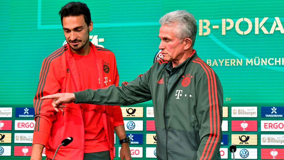 Bayern Munich's head coach Jupp Heynckes and Bayern Munich's German defender Mats Hummels arrive for a joint a press conference with Frankfurt's head coach on May 18, 2018, on the eve of the German Cup DFB Pokal final football match FC Bayern Munich versus Eintracht Frankfurt at Berlin's Olympic stadium. (Photo by Tobias SCHWARZ / AFP)        (Photo credit should read TOBIAS SCHWARZ/AFP/Getty Images)