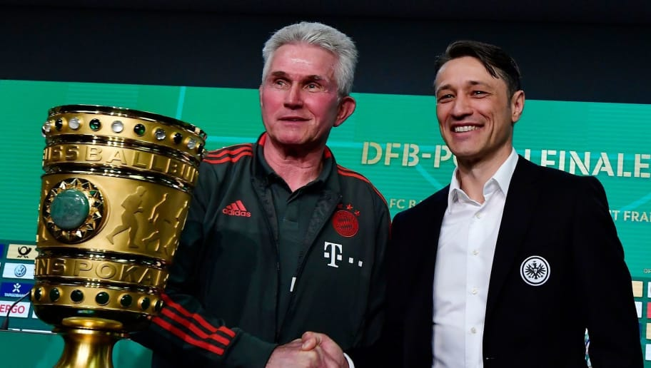 Bayern Munich's head coach Jupp Heynckes (L) and Frankfurt's Croatian head coach Niko Kovac pose next to German Cup DFB Pokal trophy during a joint press conference on May 18, 2018, on the eve of the German Cup DFB Pokal final football match Bayern Munich versus Frankfurt at Berlin's Olympic stadium. (Photo by Tobias SCHWARZ / AFP)        (Photo credit should read TOBIAS SCHWARZ/AFP/Getty Images)