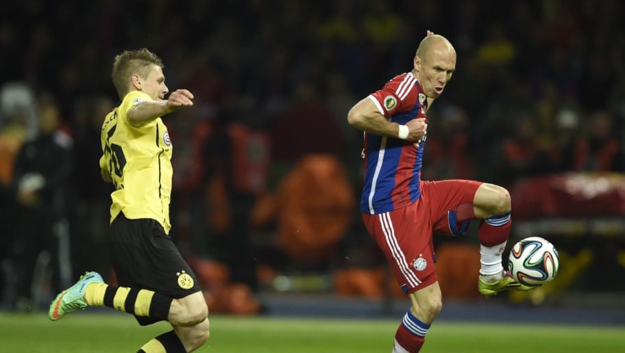 Bayern Munich's Dutch midfielder Arjen Robben (R) shoots to score as Dortmund's Polish defender Lukasz Piszczek (L) fails to save the goal during the extra-time of the DFB German Cup final football match BVB Borussia Dortmund vs Bayern Munich at the Olympic Stadium in Berlin on May 17, 2014.   AFP PHOTO / ODD ANDERSEN  RESTRICTIONS / EMBARGO  ACCORDING TO DFB RULES IMAGE SEQUENCES TO SIMULATE VIDEO IS NOT ALLOWED DURING MATCH TIME. MOBILE (MMS) USE IS NOT ALLOWED DURING AND FOR FURTHER TWO HOURS AFTER THE MATCH. FOR MORE INFORMATION CONTACT DFB DIRECTLY AT +49 69 67880        (Photo credit should read ODD ANDERSEN/AFP/Getty Images)