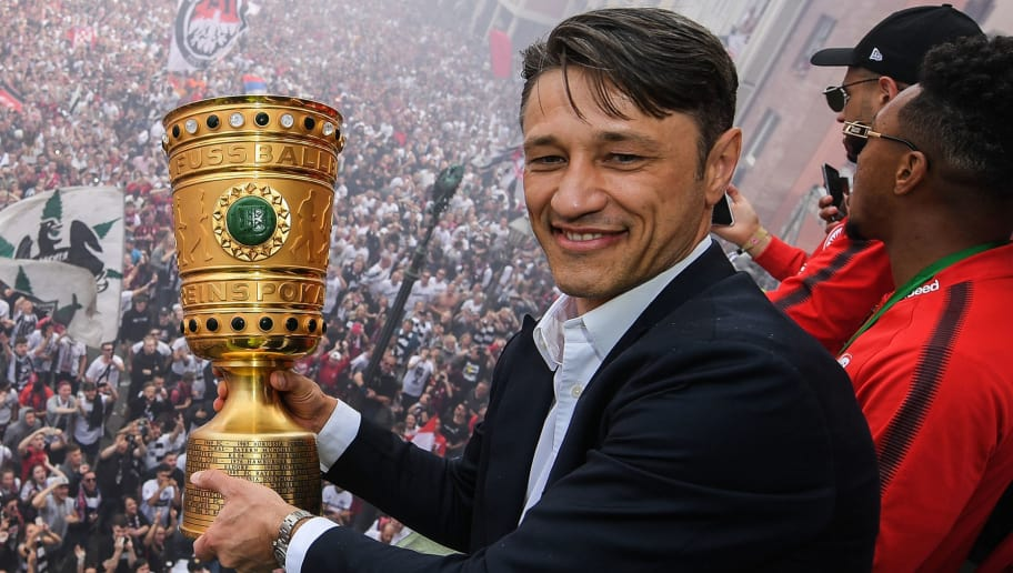 Frankfurt's Croatian head coach Niko Kovac and his players celebrate their team's victory in the German Cup DFB Pokal final on the balcony of city hall at the Roemerberg square in Frankfurt am Main on May 20, 2018. (Photo by Andreas Arnold / POOL / AFP)        (Photo credit should read ANDREAS ARNOLD/AFP/Getty Images)