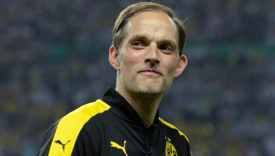 Dortmund's head coach Thomas Tuchel smiles after the German Cup (DFB Pokal) final football match Eintracht Frankfurt v BVB Borussia Dortmund at the Olympic stadium in Berlin on May 27, 2017. / AFP PHOTO / Christof STACHE / RESTRICTIONS: ACCORDING TO DFB RULES IMAGE SEQUENCES TO SIMULATE VIDEO IS NOT ALLOWED DURING MATCH TIME. MOBILE (MMS) USE IS NOT ALLOWED DURING AND FOR FURTHER TWO HOURS AFTER THE MATCH. == RESTRICTED TO EDITORIAL USE == FOR MORE INFORMATION CONTACT DFB DIRECTLY AT +49 69 67880   /         (Photo credit should read CHRISTOF STACHE/AFP/Getty Images)