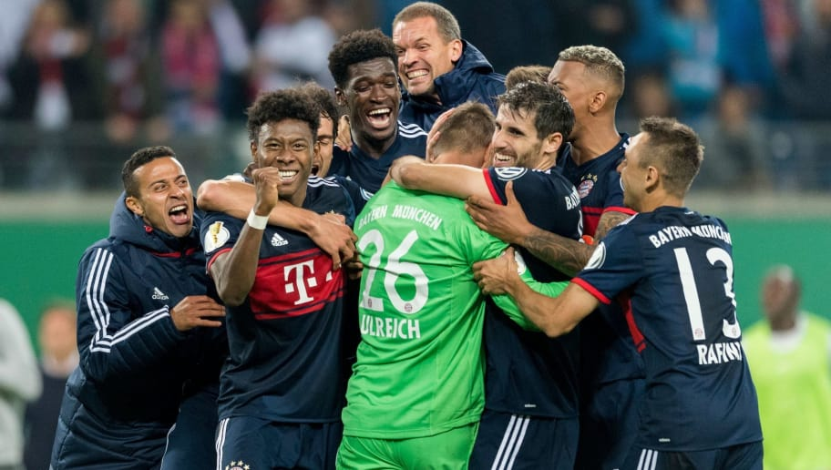 Bayern Munich's Austrian defender David Alaba (2ndL) celebrates with his teammates after winning the penalty shoot out and the match after the German Cup (DFB Pokal) football match RB Leipzig v FC Bayern Munich in Leipzig, eastern Germany on October 25, 2017.    / AFP PHOTO / ROBERT MICHAEL / RESTRICTIONS: DURING MATCH TIME: DFL RULES TO LIMIT THE ONLINE USAGE TO 15 PICTURES PER MATCH AND FORBID IMAGE SEQUENCES TO SIMULATE VIDEO. == RESTRICTED TO EDITORIAL USE == FOR FURTHER QUERIES PLEASE CONTACT DFL DIRECTLY AT + 49 69 650050         (Photo credit should read ROBERT MICHAEL/AFP/Getty Images)
