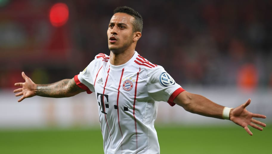 Bayern Munich's Spanish midfielder Thiago Alcantara celebrates during the German football Cup DFB Pokal semifinal match Bayer 04 Leverkusen vs Bayern Munich in Leverkusen, western Germany, on April 17, 2018. / AFP PHOTO / Patrik STOLLARZ / RESTRICTIONS: ACCORDING TO DFB RULES IMAGE SEQUENCES TO SIMULATE VIDEO IS NOT ALLOWED DURING MATCH TIME. MOBILE (MMS) USE IS NOT ALLOWED DURING AND FOR FURTHER TWO HOURS AFTER THE MATCH. == RESTRICTED TO EDITORIAL USE == FOR MORE INFORMATION CONTACT DFB DIRECTLY AT +49 69 67880   /         (Photo credit should read PATRIK STOLLARZ/AFP/Getty Images)