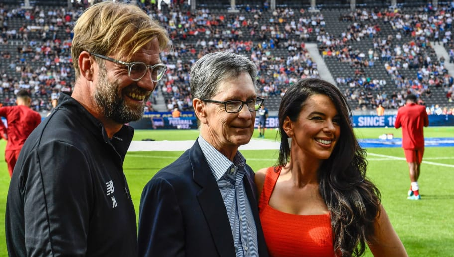 Liverpool's German manager Jurgen Klopp (L), US businessman and co-owner of Liverpool FC John Henry, and his wife Linda Pizzuti Henry, managing director of the Boston Globe newspaper (R) pose for photographers before the friendly football match Hertha Berlin vs Liverpool in Berlin, Germany, on July 29, 2017 to mark both clubs' 125th anniversary. / AFP PHOTO / John MACDOUGALL        (Photo credit should read JOHN MACDOUGALL/AFP/Getty Images)
