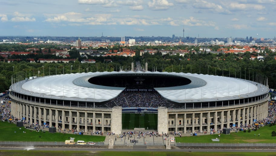 General exterior view of Berlin's Olympic stadium (Olympiastadion) taken as supporters arrive to attend the friendly football match Hertha Berlin vs Real Madrid on July 27, 2011. Real Madrid won 1-3.      AFP PHOTO / PATRIK STOLLARZ        (Photo credit should read PATRIK STOLLARZ/AFP/Getty Images)