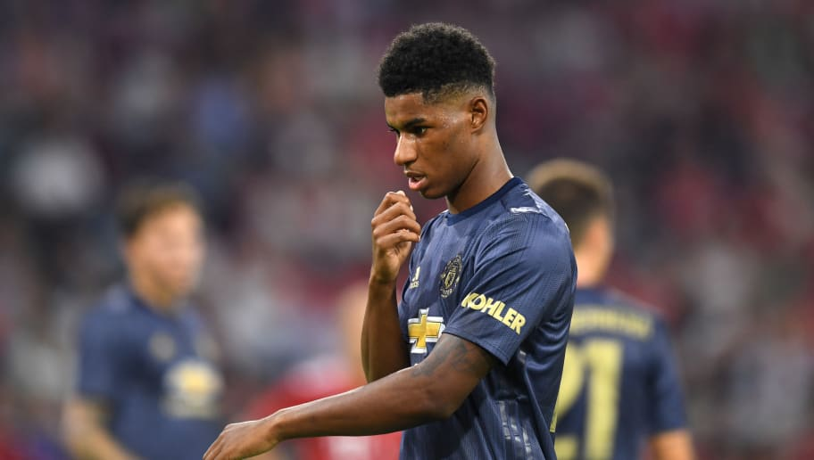 Manchester United's English striker Marcus Rashford reacts during the pre-season friendly football match between FC Bayern Munich and Manchester United at the Allianz Arena in Munich, southern Germany on August 5, 2018. (Photo by Christof STACHE / AFP)        (Photo credit should read CHRISTOF STACHE/AFP/Getty Images)
