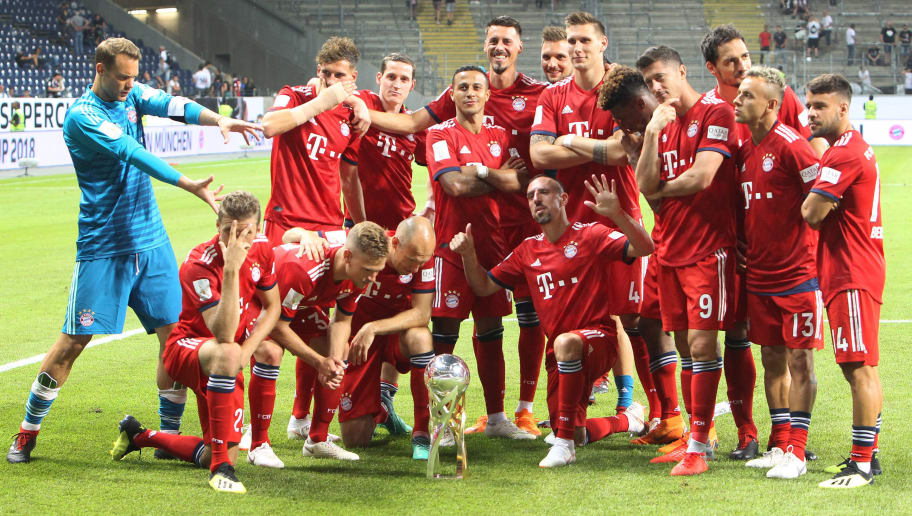 Bayern Munich players celebrate with the trophy after winning the German Supercup football match between Eintracht Frankfurt and Bayern Munich in Frankfurt am Main, western Germany, on August 12, 2018. (Photo by Daniel ROLAND / AFP) / RESTRICTIONS: ACCORDING TO DFB RULES IMAGE SEQUENCES TO SIMULATE VIDEO IS NOT ALLOWED DURING MATCH TIME. MOBILE (MMS) USE IS NOT ALLOWED DURING AND FOR FURTHER TWO HOURS AFTER THE MATCH. == RESTRICTED TO EDITORIAL USE == FOR MORE INFORMATION CONTACT DFB DIRECTLY AT +49 69 67880 /         (Photo credit should read DANIEL ROLAND/AFP/Getty Images)