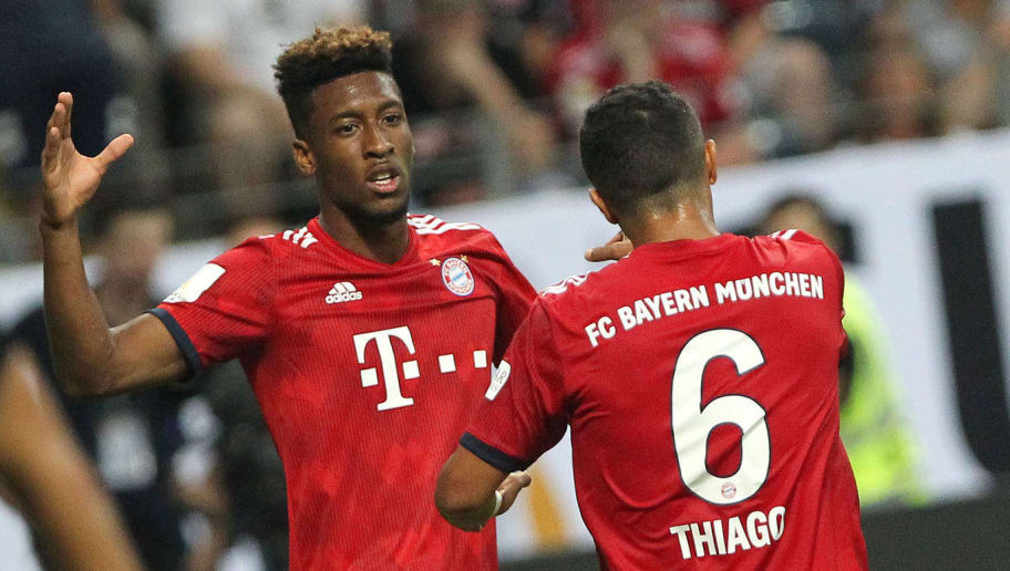 Bayern Munich's Spanish midfielder Thiago Alcantara (R) celebrates scoring his side 5th goal on the night with team mate Bayern Munich's French forward Kingsley Coman during the German Supercup football match between Eintracht Frankfurt and Bayern Munich in Frankfurt am Main, western Germany, on August 12, 2018. (Photo by Daniel ROLAND / AFP) / RESTRICTIONS: ACCORDING TO DFB RULES IMAGE SEQUENCES TO SIMULATE VIDEO IS NOT ALLOWED DURING MATCH TIME. MOBILE (MMS) USE IS NOT ALLOWED DURING AND FOR FURTHER TWO HOURS AFTER THE MATCH. == RESTRICTED TO EDITORIAL USE == FOR MORE INFORMATION CONTACT DFB DIRECTLY AT +49 69 67880 /         (Photo credit should read DANIEL ROLAND/AFP/Getty Images)