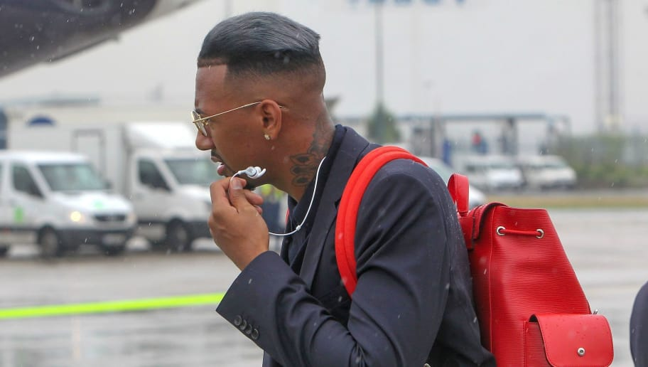 Germany's defender Jerome Boateng of the German national football team is about to board their plane for Moscow to take part in the 2018 FIFA World Cup in Russiaon June 12, 2018 at their departure from Frankfurt international airport. (Photo by Daniel ROLAND / AFP)        (Photo credit should read DANIEL ROLAND/AFP/Getty Images)