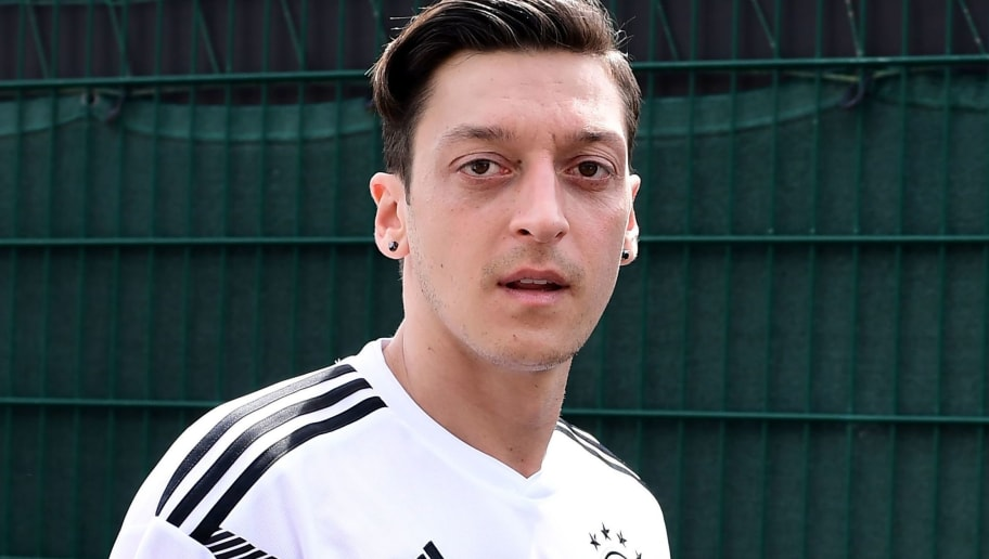 German national football team midfielder Mesut Ozil poses on May 26, 2018 at the Rungghof training center in Girlan, near Bolzano, ahead of the FIFA World Cup 2018 in Russia. - The 'Mannschaft' stays for trainings in Rungghof until June 7, 2018. (Photo by MIGUEL MEDINA / AFP)        (Photo credit should read MIGUEL MEDINA/AFP/Getty Images)