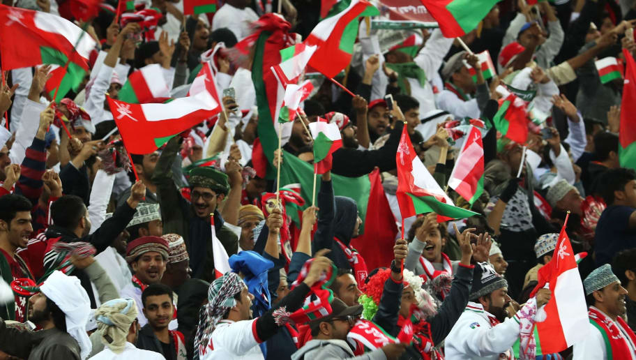 Omani fans wave their national flag as they celebrate after their national team scored a  goal during the 2017 Gulf Cup of Nations semi-final football match between Oman and Bahrain at the Sheikh Jaber al-Ahmad Stadium in Kuwait City on January 2, 2018.  / AFP PHOTO / Yasser Al-Zayyat        (Photo credit should read YASSER AL-ZAYYAT/AFP/Getty Images)