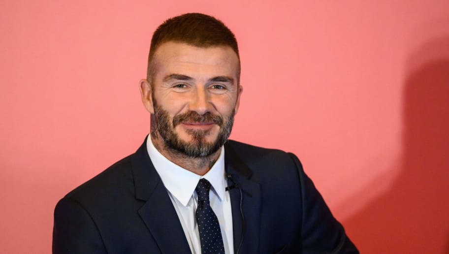 Former England footballer David Beckham speaks during a promotional event where he appeared as the global brand ambassador for insurance company AIA in Hong Kong on September 24, 2018. (Photo by Anthony WALLACE / AFP)        (Photo credit should read ANTHONY WALLACE/AFP/Getty Images)