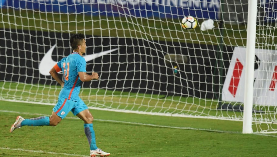 India's captain Sunil Chhetri celebrates after scoring a goal during the Hero Intercontinental Cup football match between India and Kenya, in Mumbai, on June 4, 2018. - India's football international against Kenya on Monday sold out in hours following captain Sunil Chhetri's emotional plea for fans to support the team after barely 2,500 people turned up to watch them play last week. (Photo by PUNIT PARANJPE / AFP)        (Photo credit should read PUNIT PARANJPE/AFP/Getty Images)